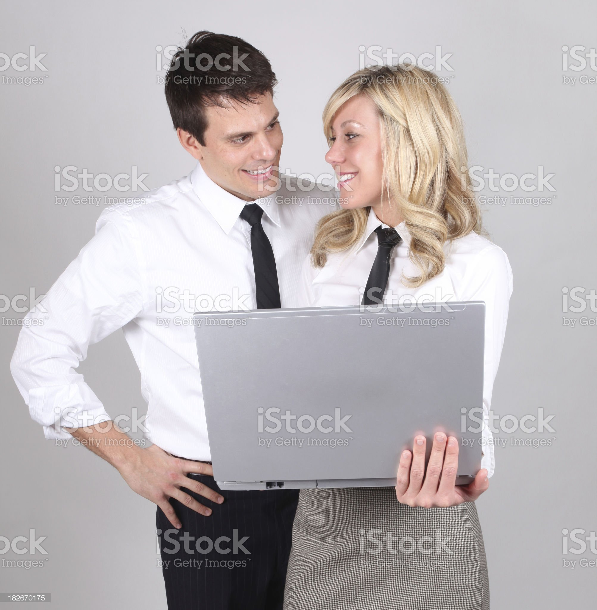 Business couple working on laptop royalty-free stock photo