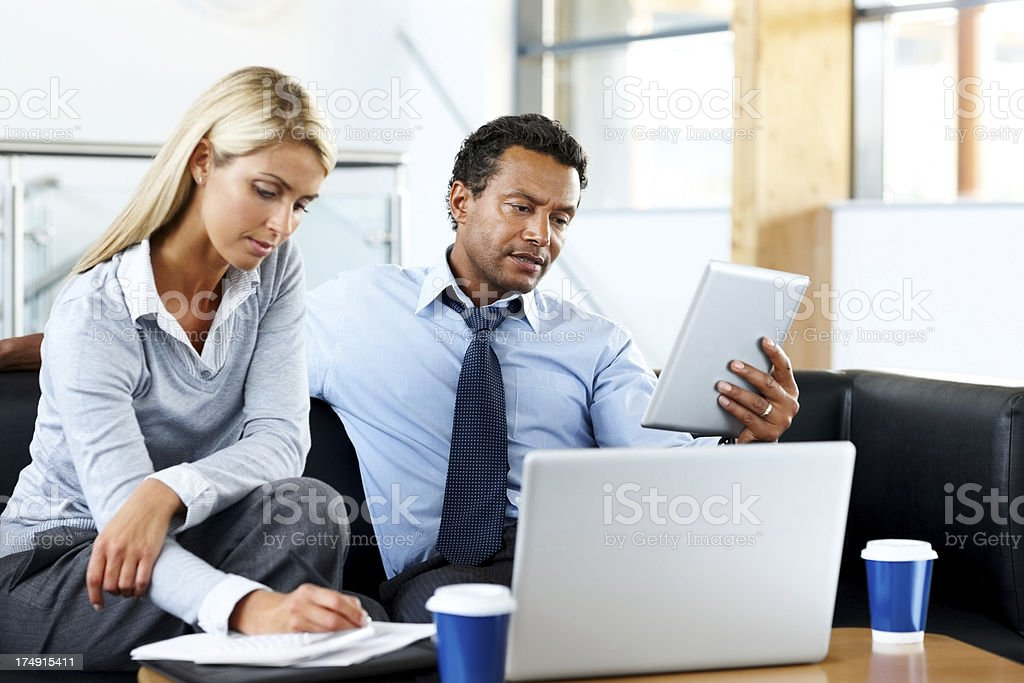 Business couple working on new project royalty-free stock photo