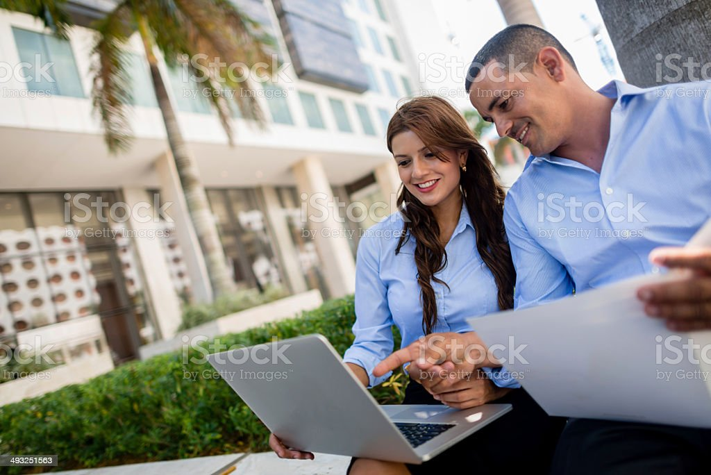 Business couple working outdoors stock photo