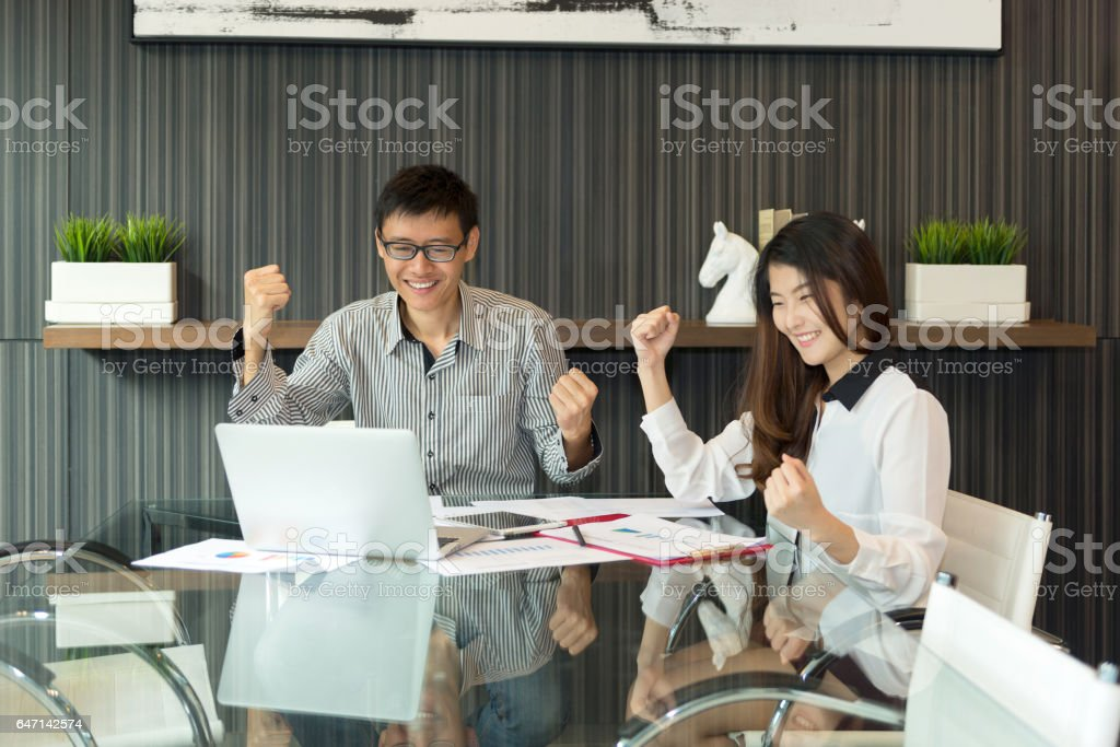 Business Coworkers discussing in meeting room in modern space, people stock photo