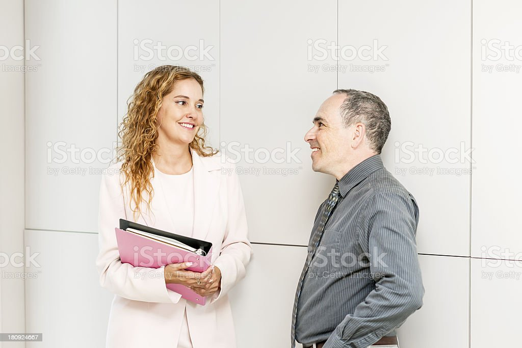 Business coworkers talking in hallway royalty-free stock photo