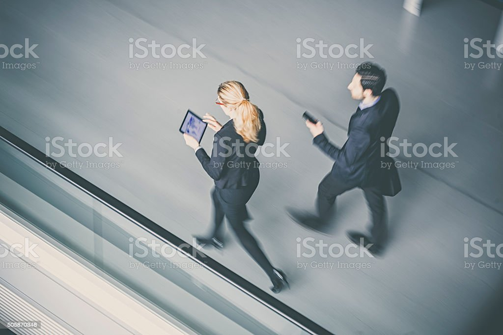 Business coworkers  walking together in office building stock photo