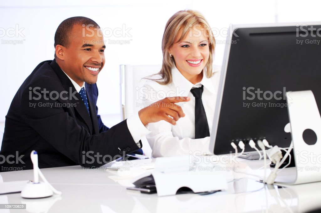 Business co-workers working on computer. royalty-free stock photo