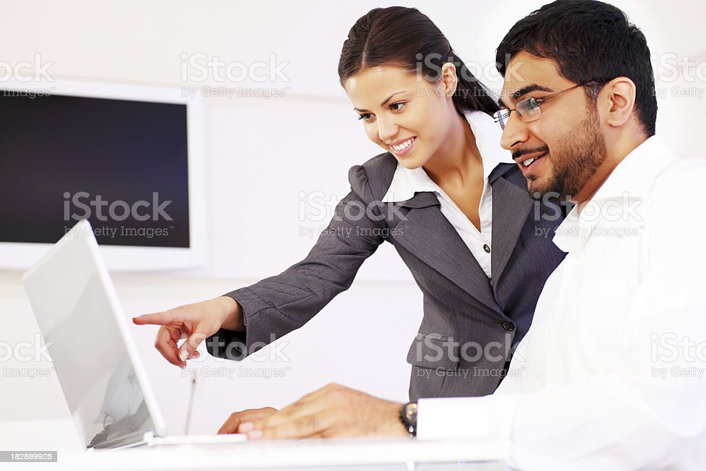 Business co-workers working on laptop. royalty-free stock photo