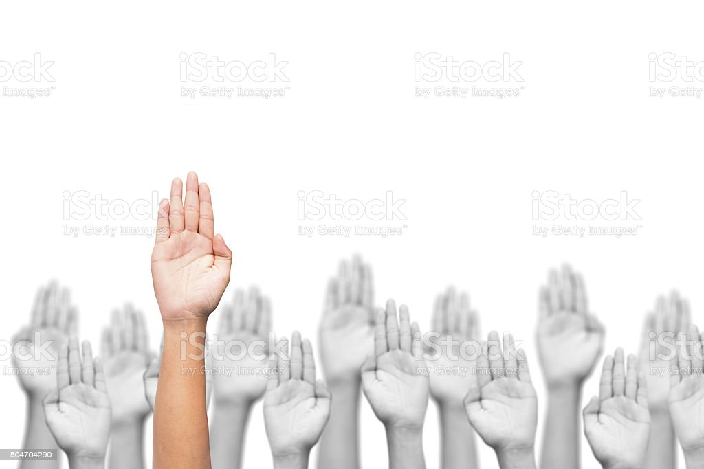 business crowd raising hands, many hands raise high up stock photo