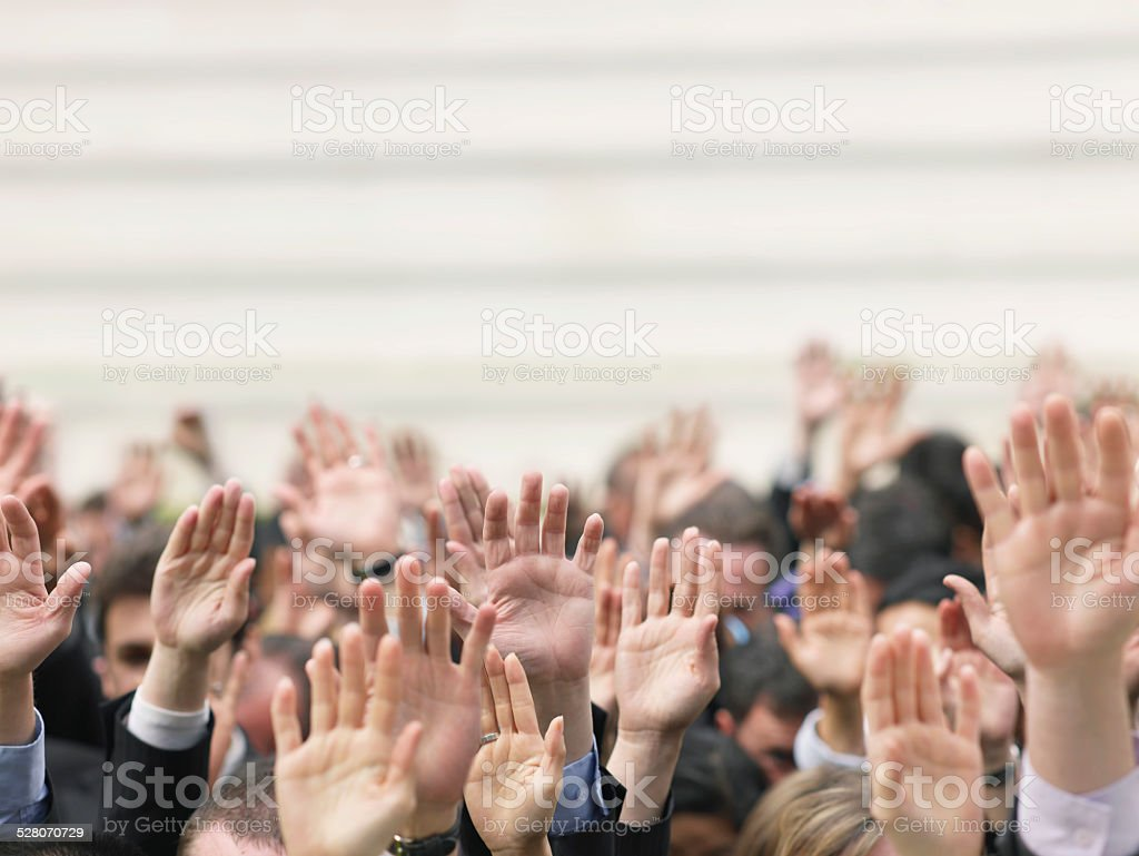 Business Crowd Raising Hands stock photo