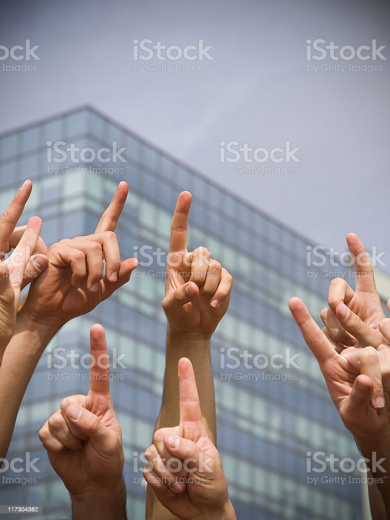 Business crowd with hands in the air royalty-free stock photo