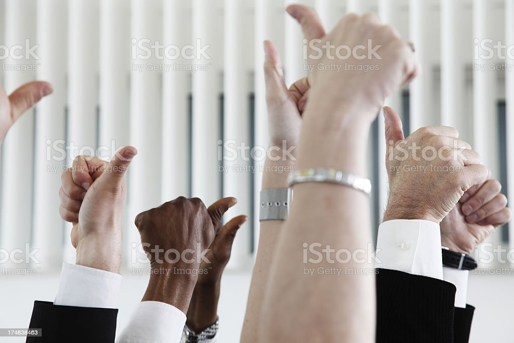 Business crowd with thumbs-up in the air royalty-free stock photo