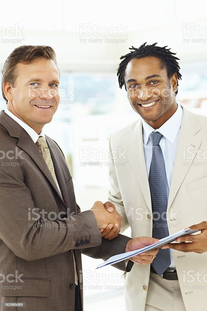 Business deal - Happy businessmen shaking hands royalty-free stock photo