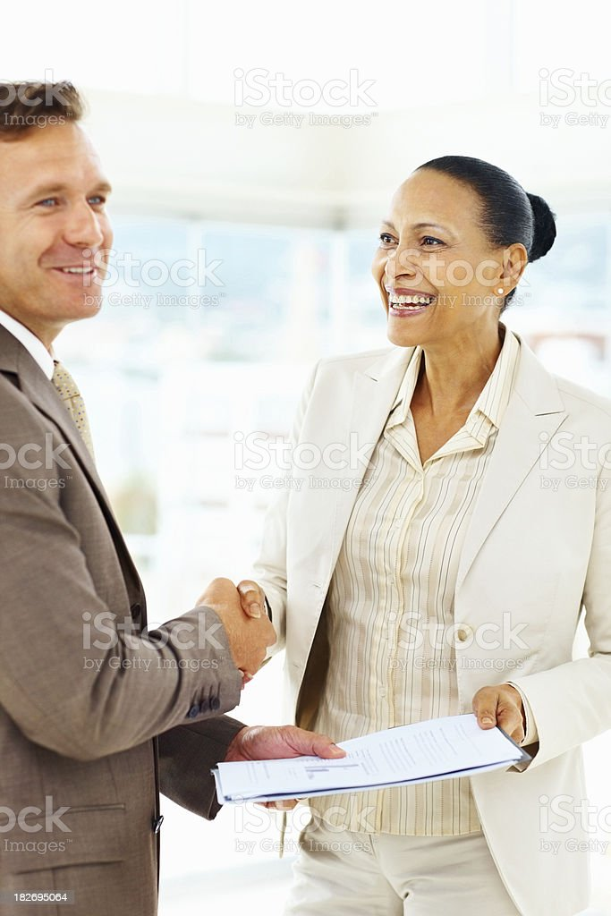 Business deal - Happy executives shaking hands royalty-free stock photo