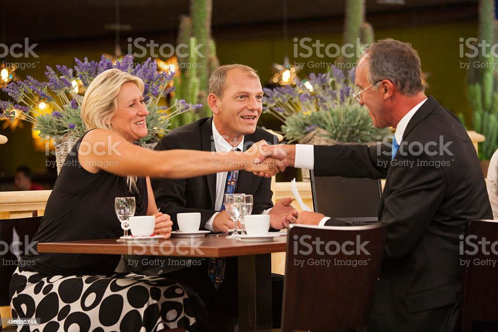 Business deal in restaurant stock photo