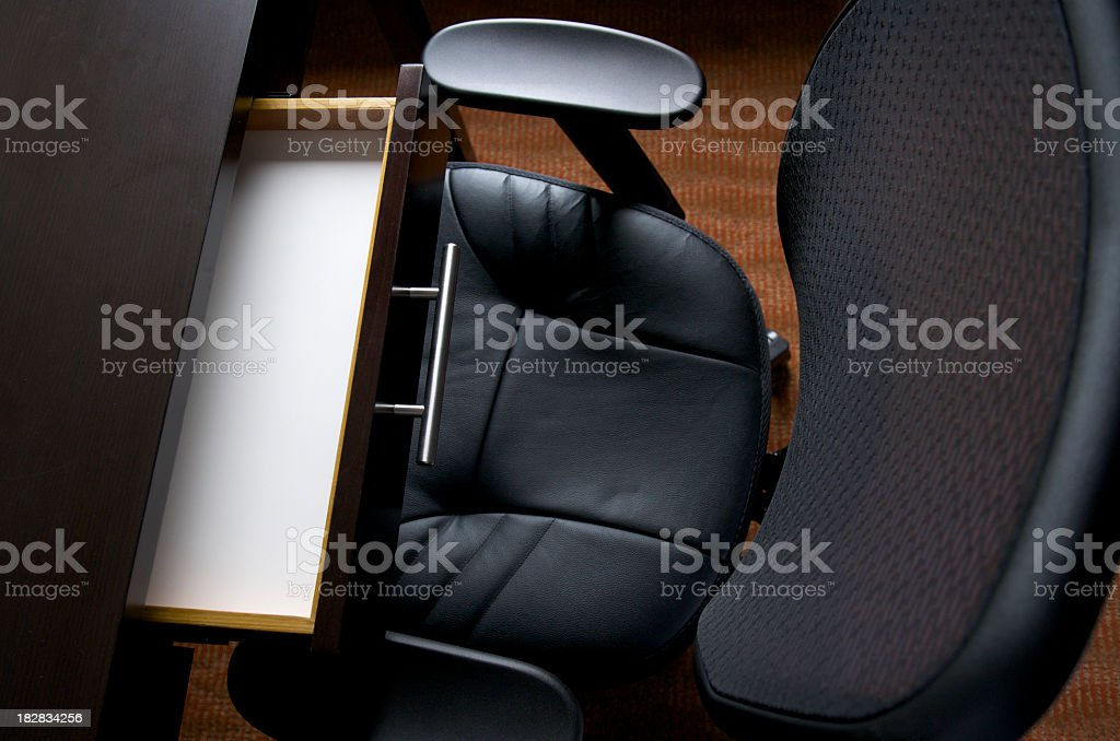 Business Desk with Open Drawer and Office Chair stock photo