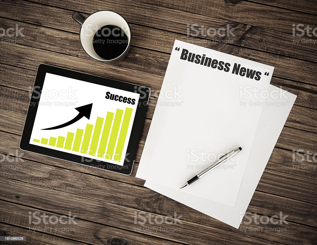 Business desk with tablet and mug royalty-free stock photo