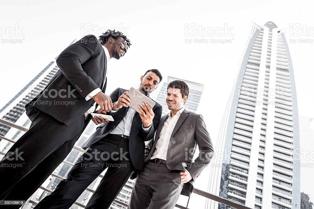 Business Discussion with Digital Tablet Outside their office stock photo