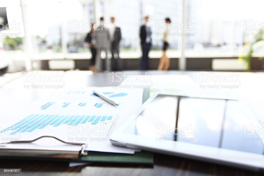 business document in touchpad lying on the desk stock photo
