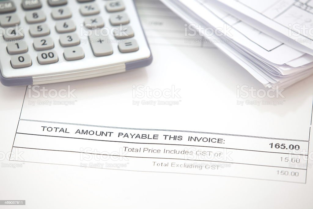 Business document of tax invoice form with calculator stock photo