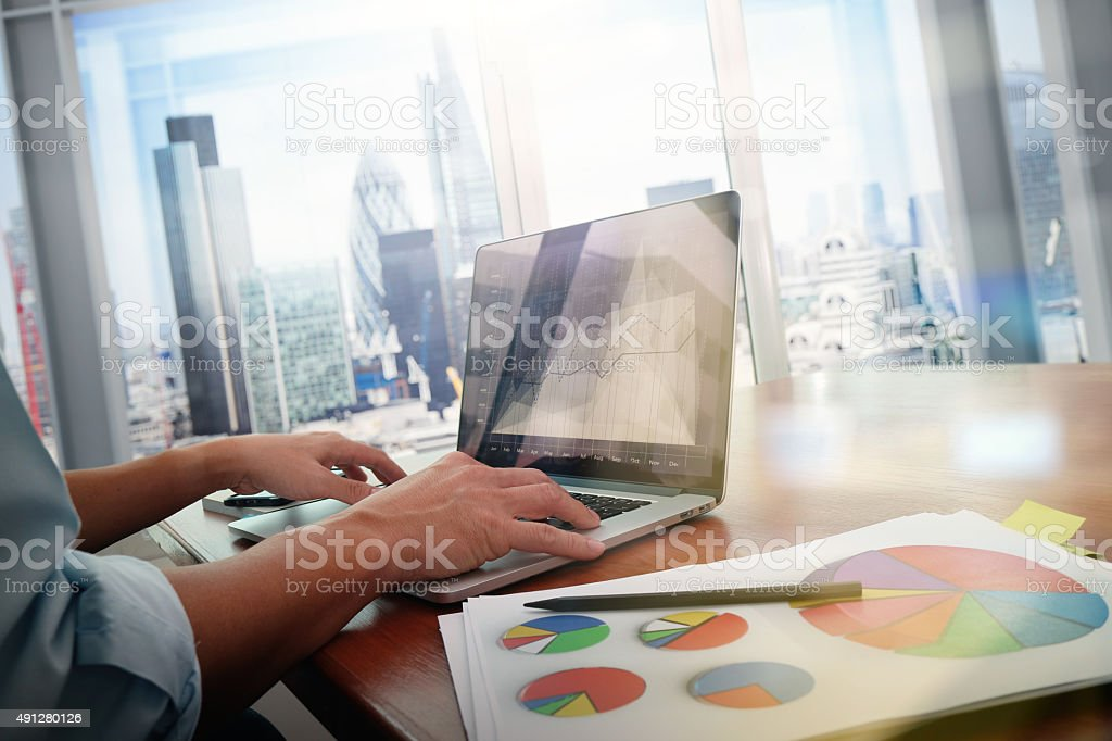 business documents on office table with smart phone and laptop stock photo