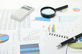 Business documents with numbers and charts.