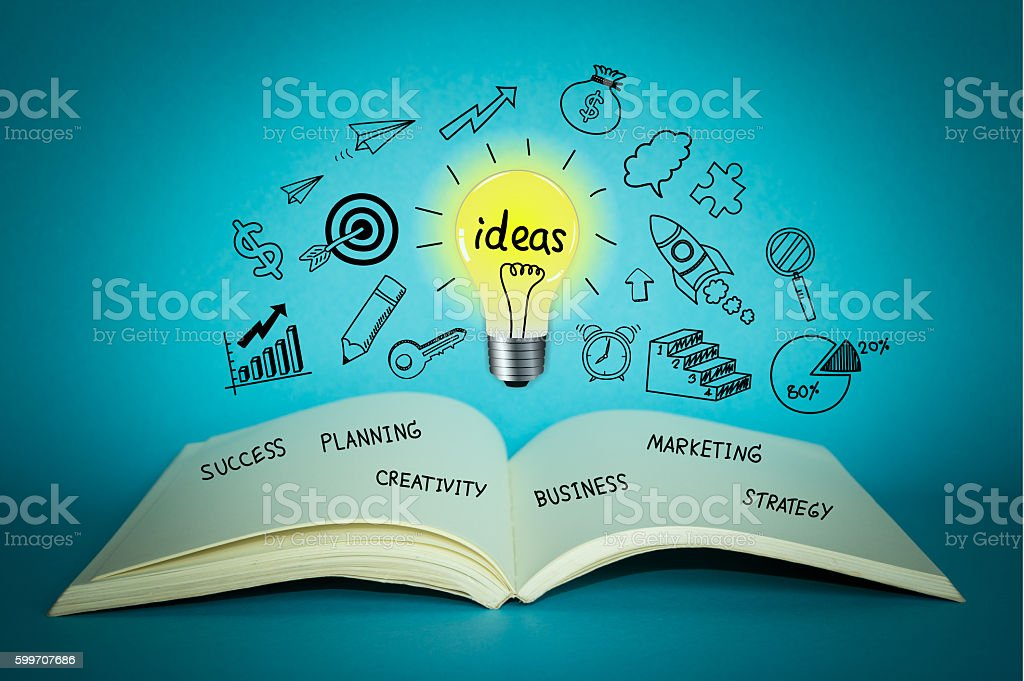Business doodle with light bulb on notebook for creative ideas stock photo