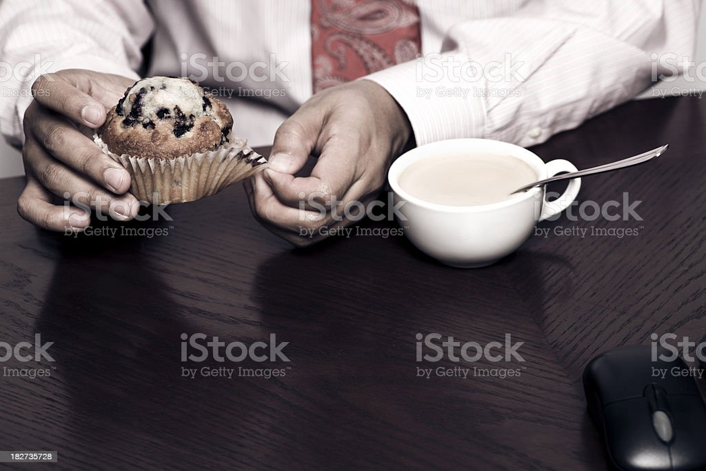business eating a muffin and coffee royalty-free stock photo
