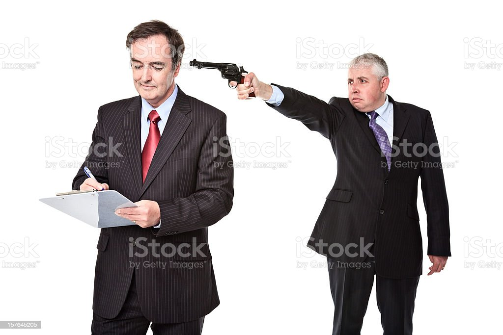 Business employee shooting his colleague / boss royalty-free stock photo