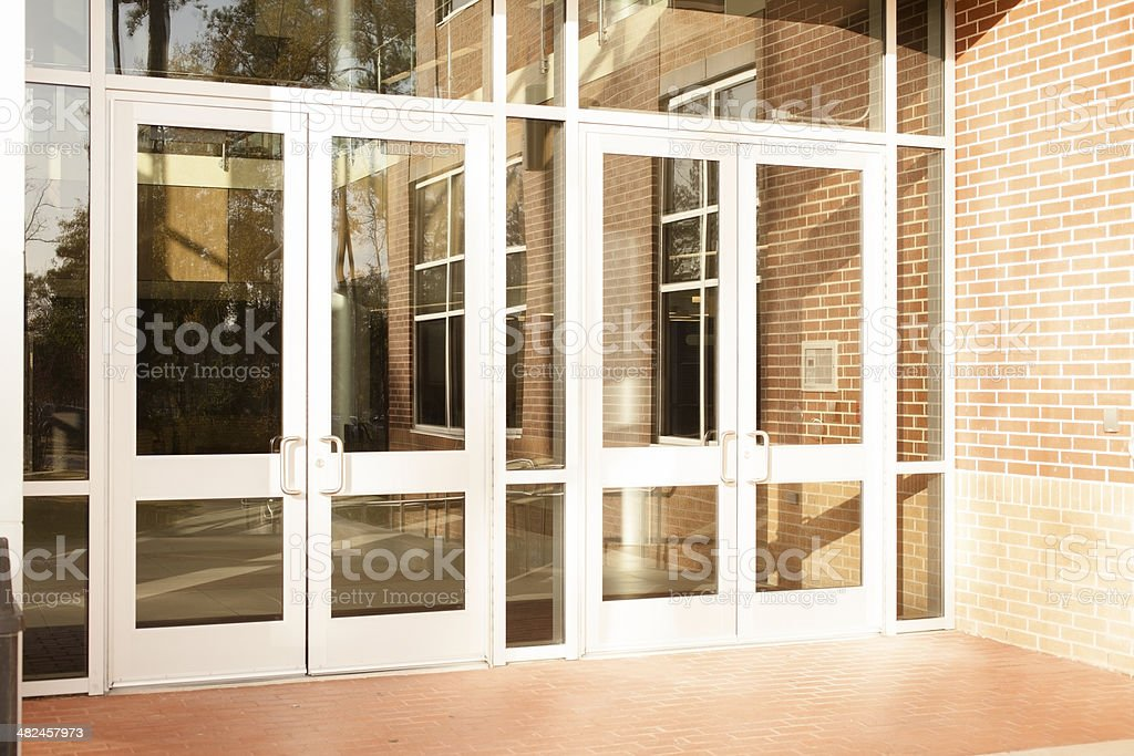 Business: Empty office building, school.  Front doors are closed. stock photo