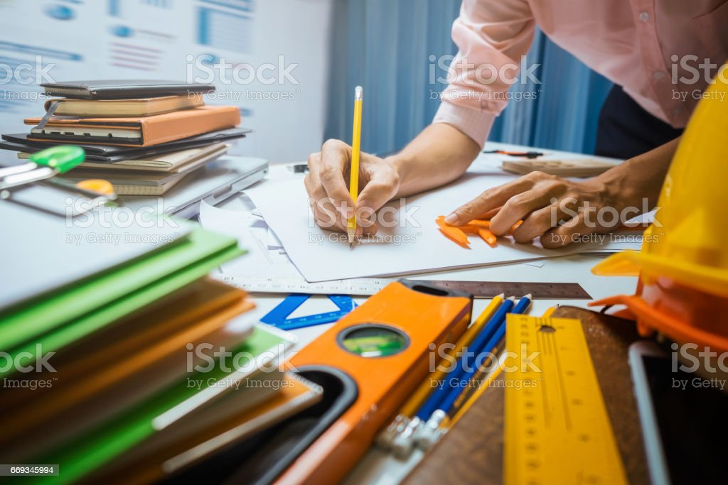 Business engineer contractor working at his desk table in office. stock photo