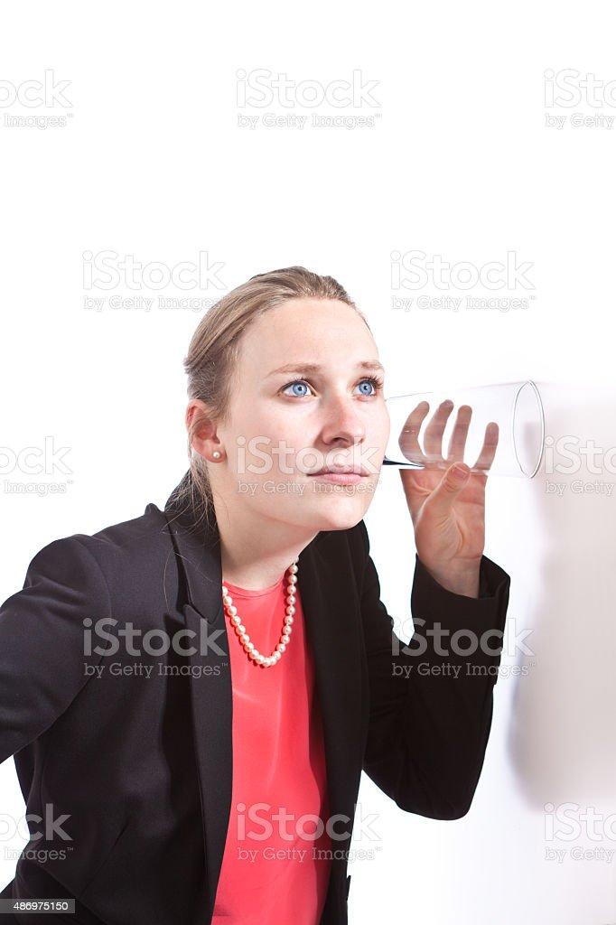 Business Espionage Spy Woman Listening on Wall stock photo