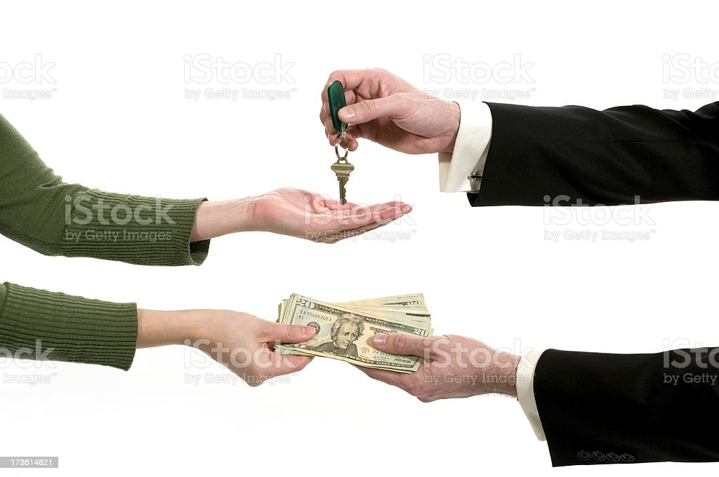 Business exchange with money and a key stock photo