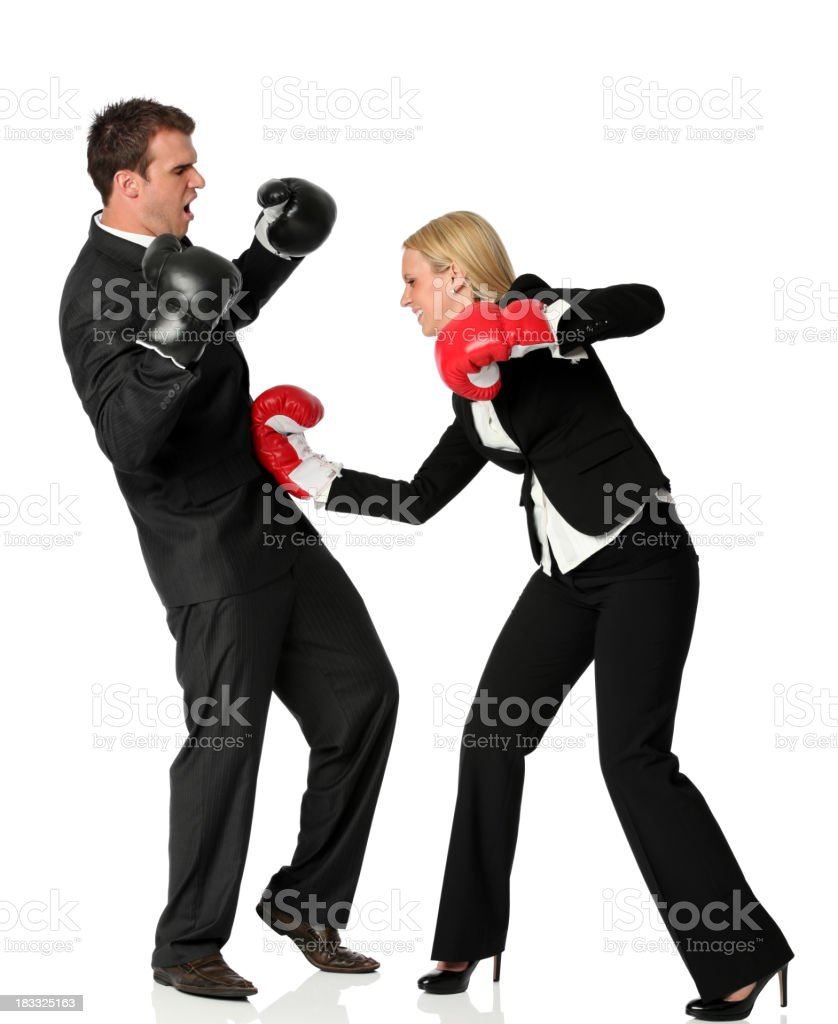 Business excutives fighting in boxing gloves royalty-free stock photo