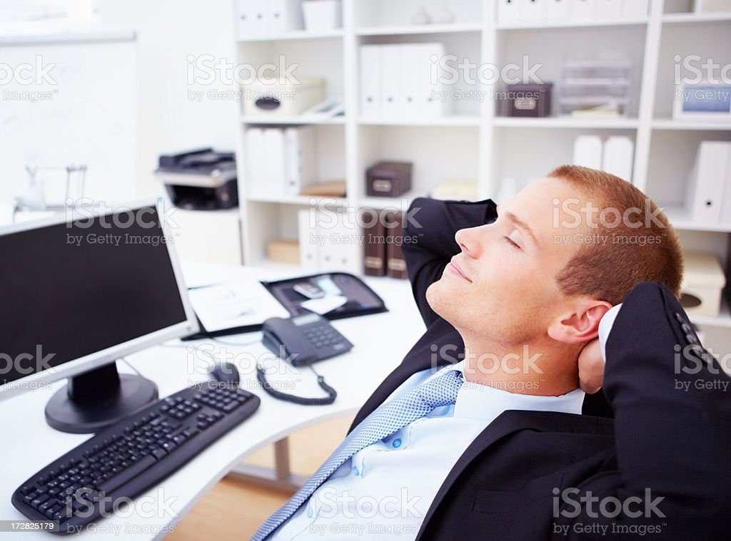 A business executive dreaming at work stock photo