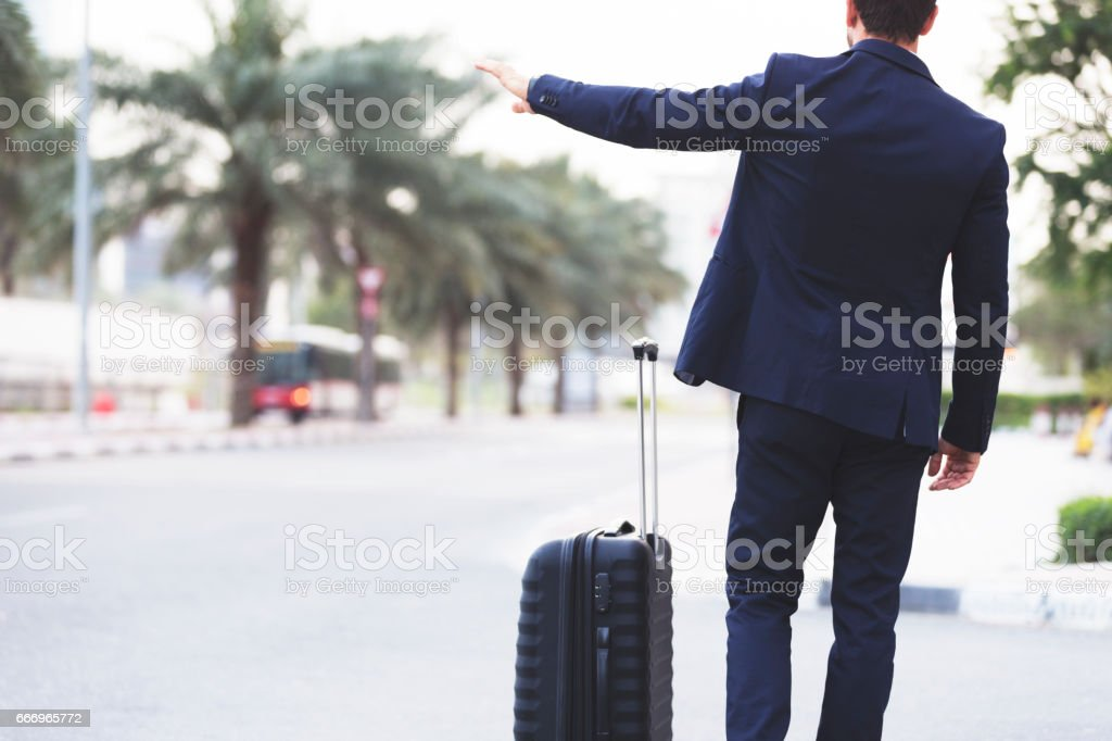 Business Executive hailing a cab on the street stock photo