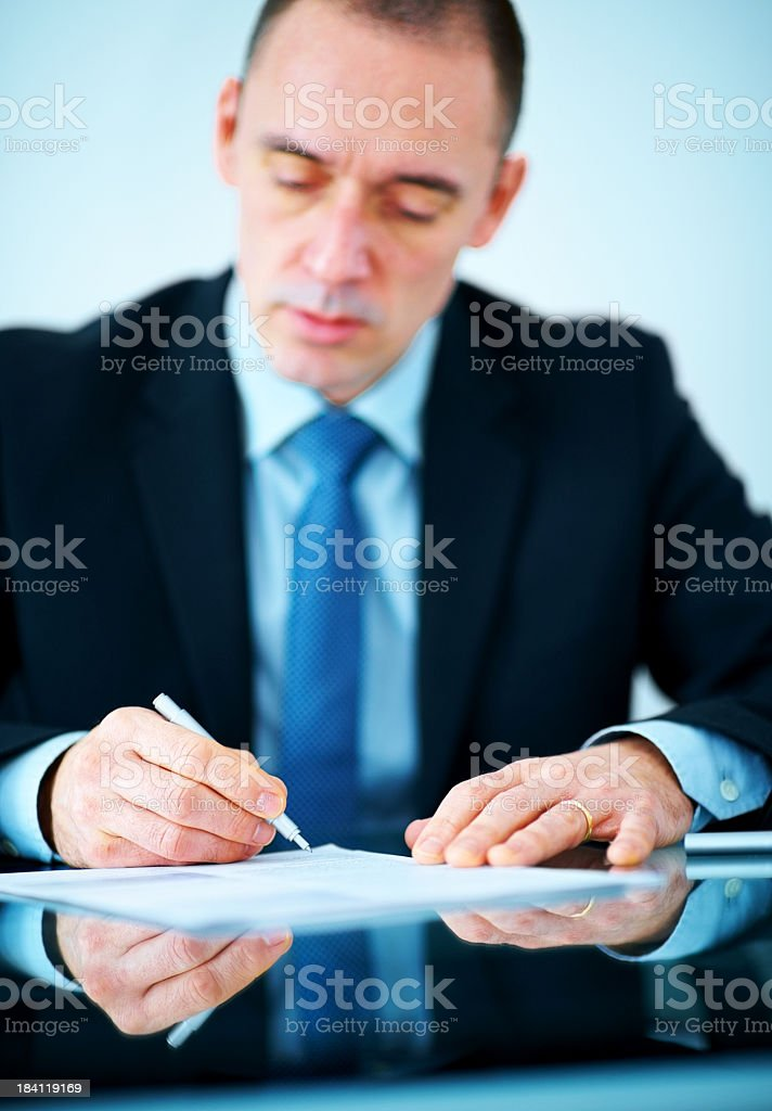 Business executive signing an agreement paper at office royalty-free stock photo