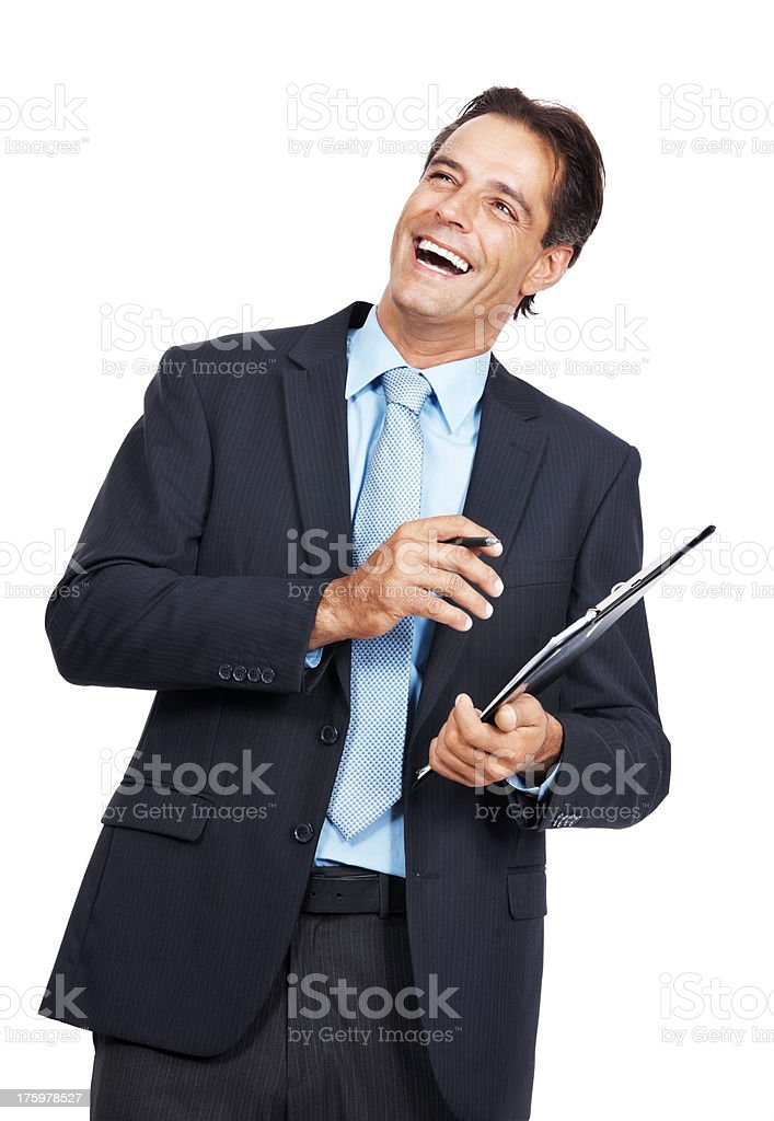 Business executive smiling while writing notes  stock photo