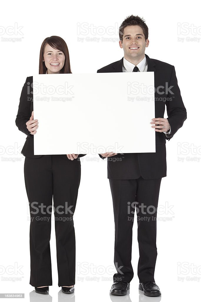 Business executive standing with a placard royalty-free stock photo