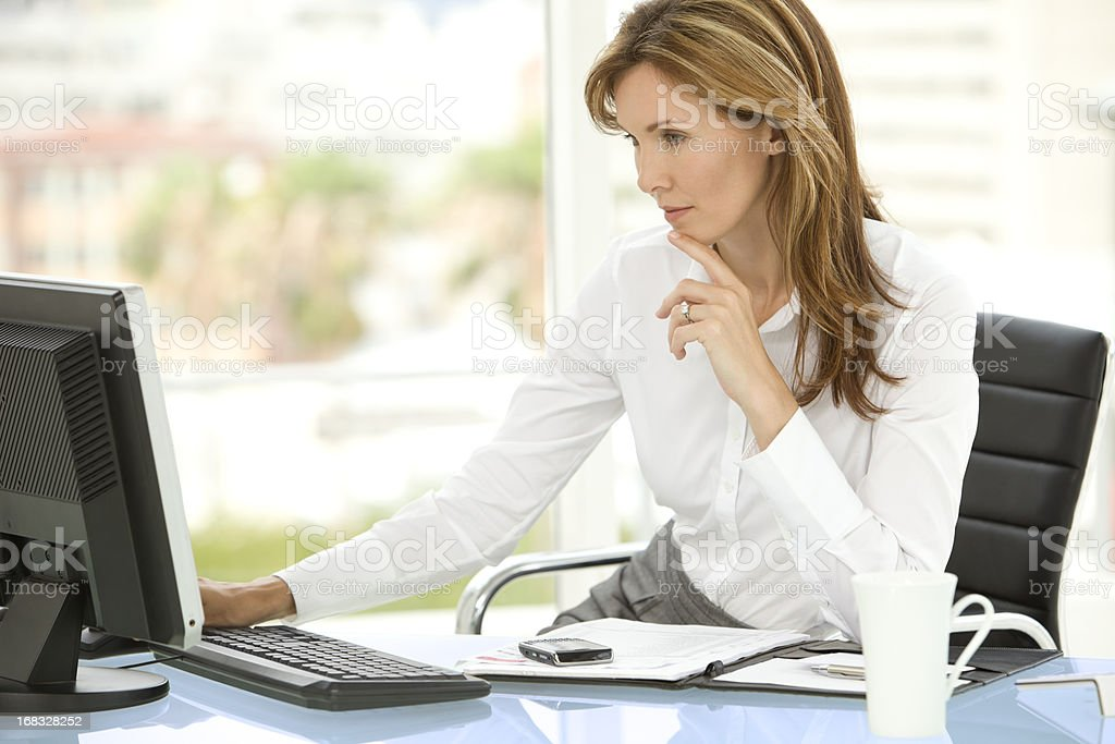 Business Executive woman using computer at workplace royalty-free stock photo