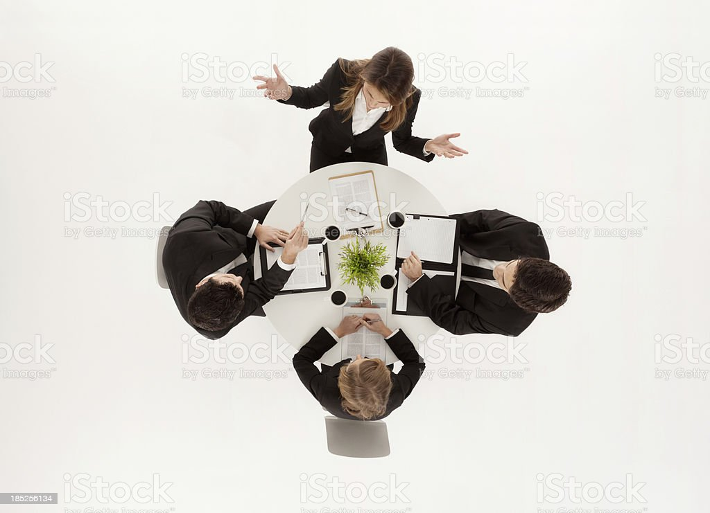 Business executives discussing in a meeting stock photo