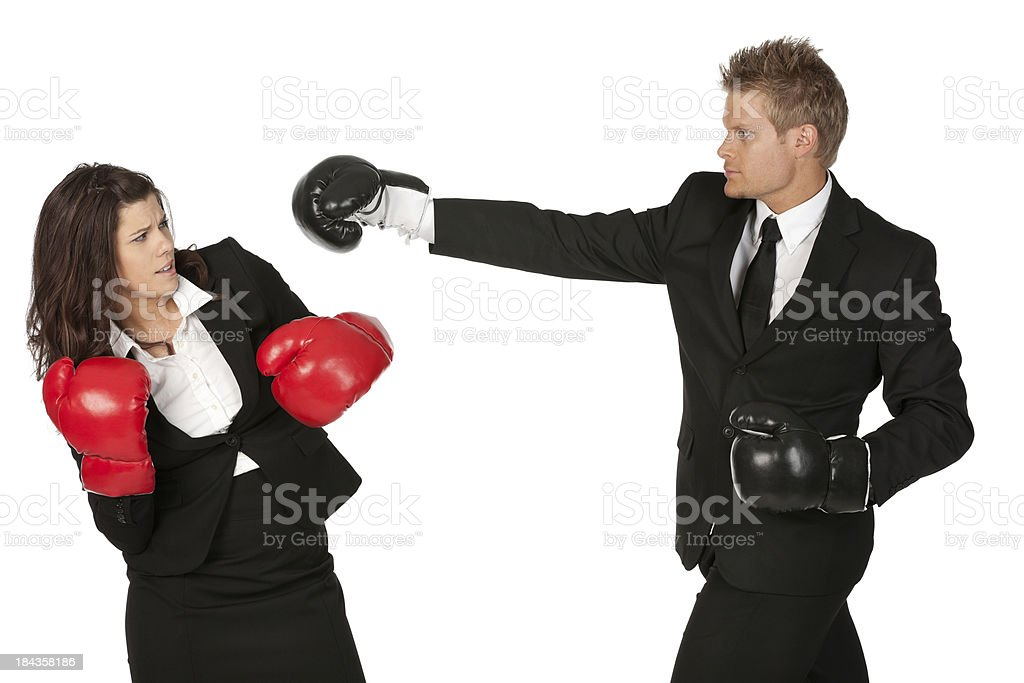 Business executives fighting in boxing gloves royalty-free stock photo