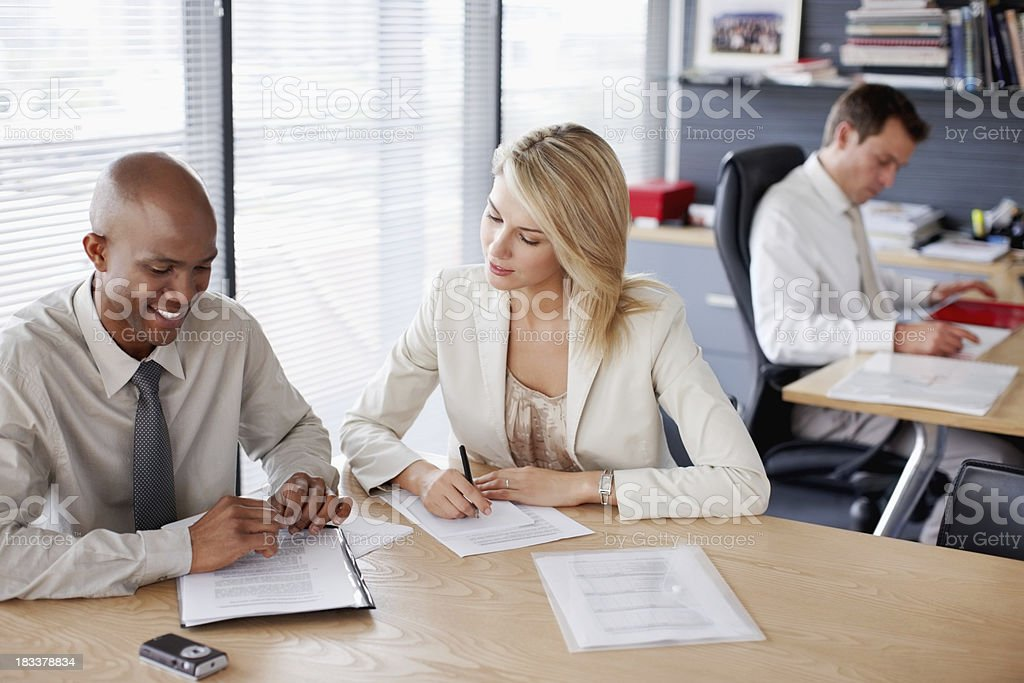 Business executives going through a document royalty-free stock photo