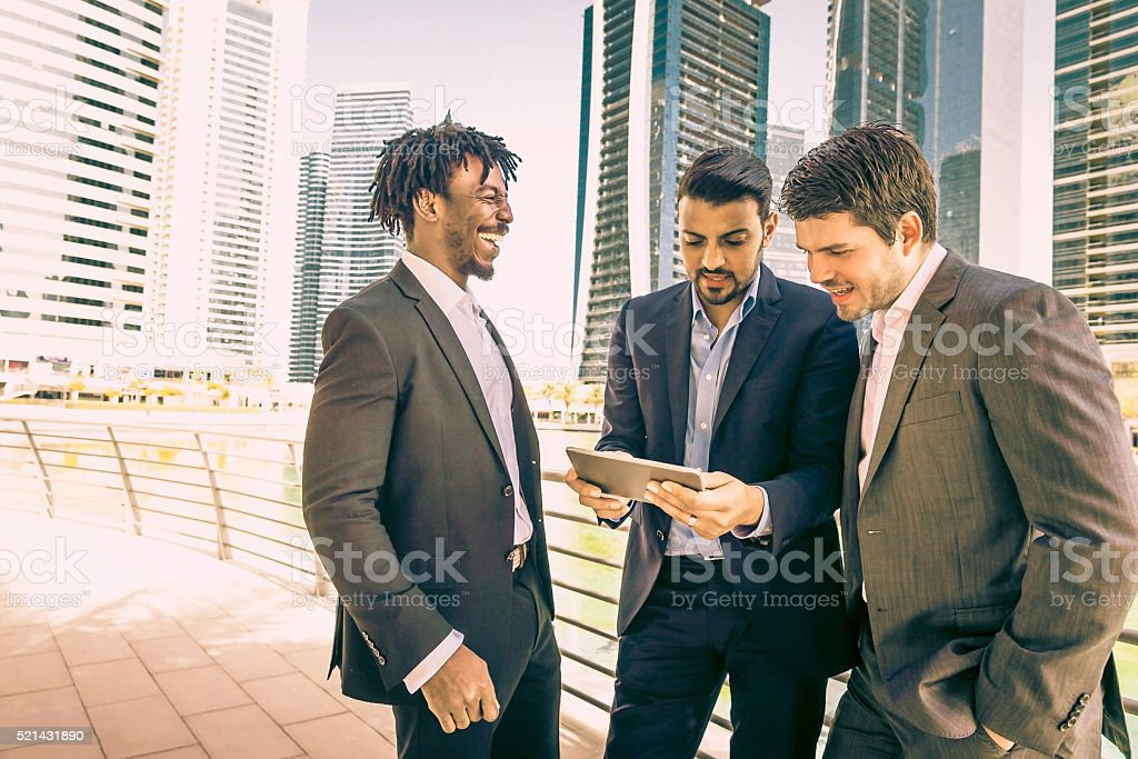 Business Executives having fun with their digital tablet stock photo
