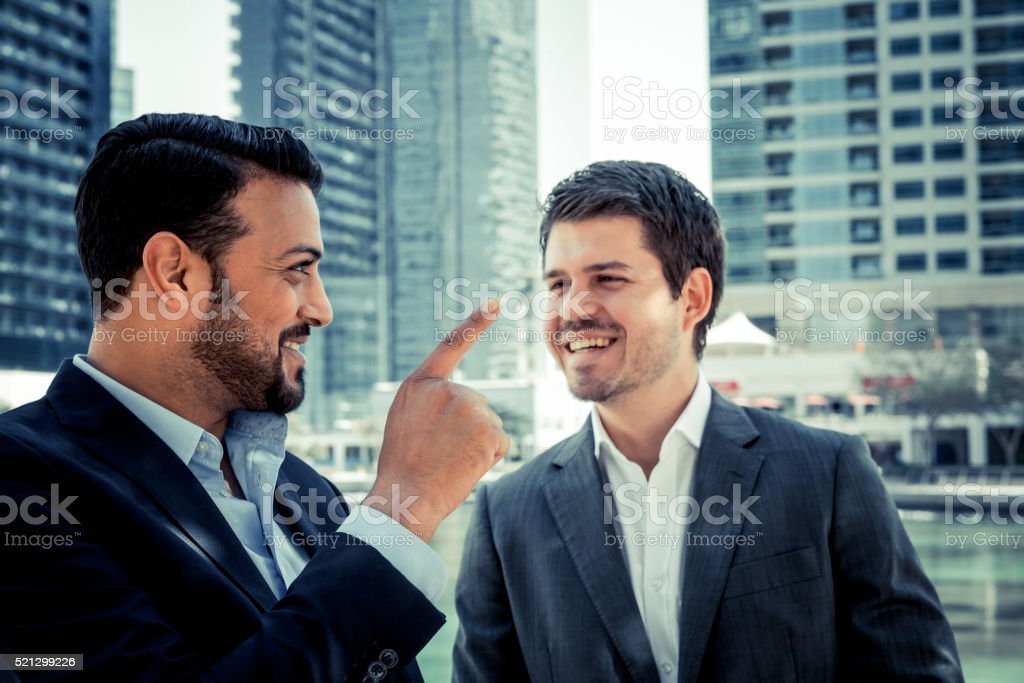 Business Executives Joining Hands in Agreement stock photo