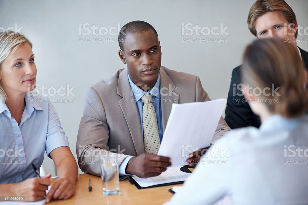 Business executives listening to the interviewee royalty-free stock photo