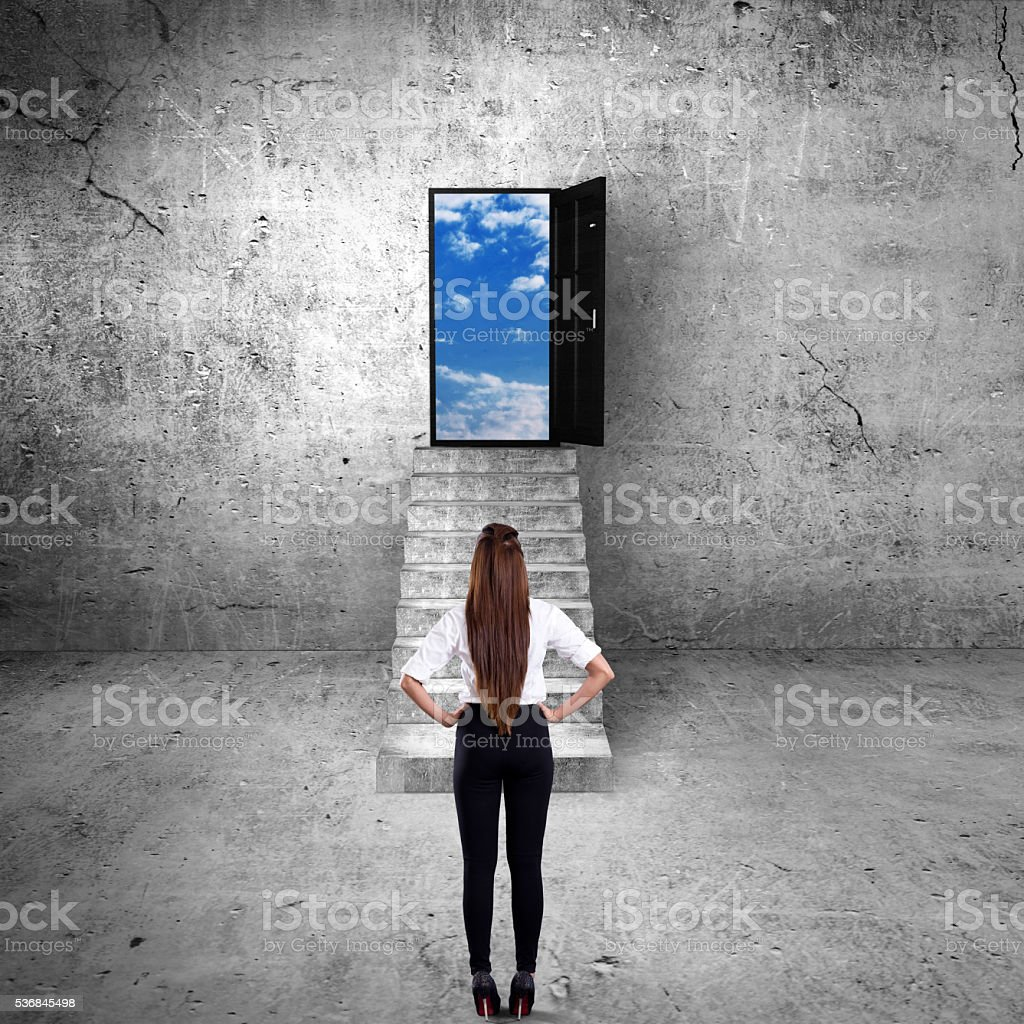 Business executives looking at open door stock photo