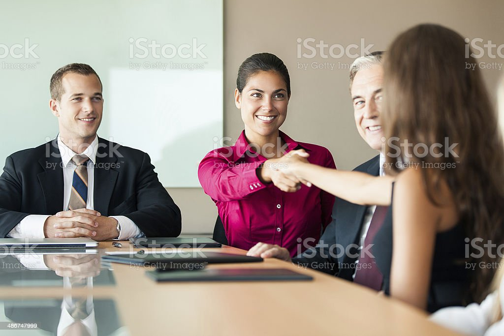 Business executives shaking hands in an office meeting royalty-free stock photo