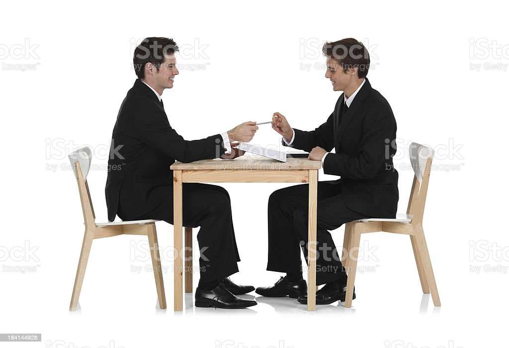 Business executives signing a deal royalty-free stock photo