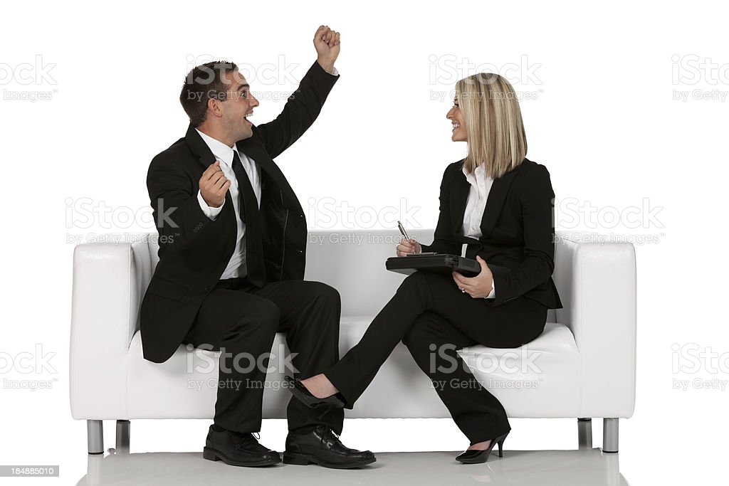 Business executives sitting on a couch royalty-free stock photo