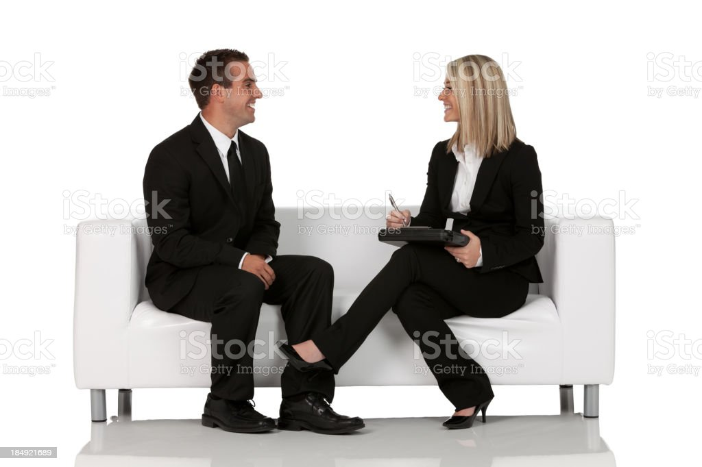 Business executives sitting on couch stock photo