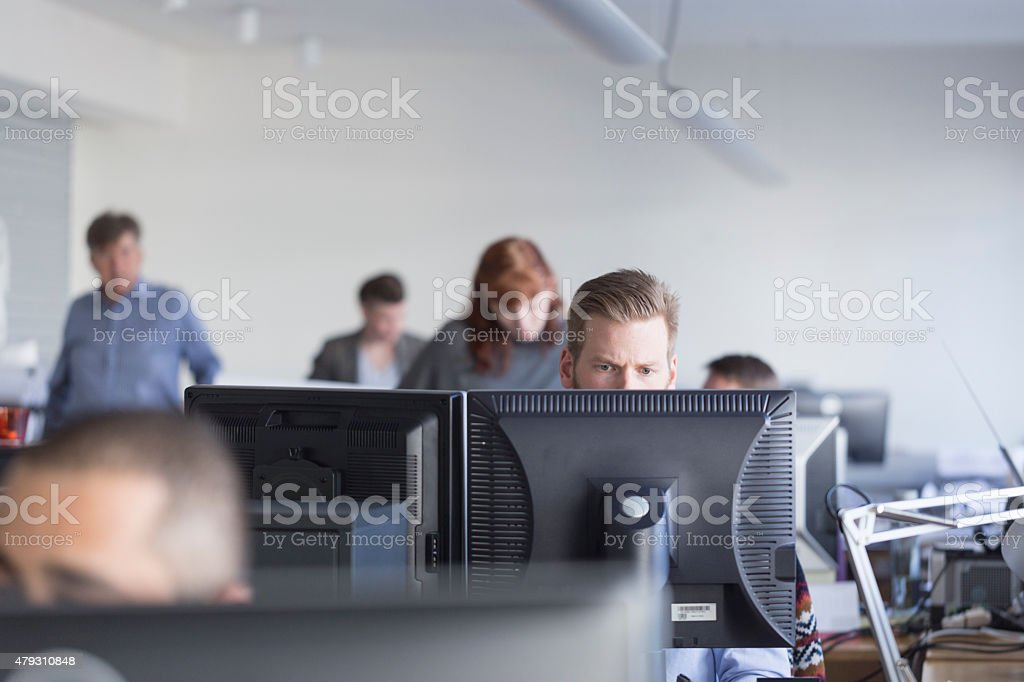 Business executives using computers in office stock photo
