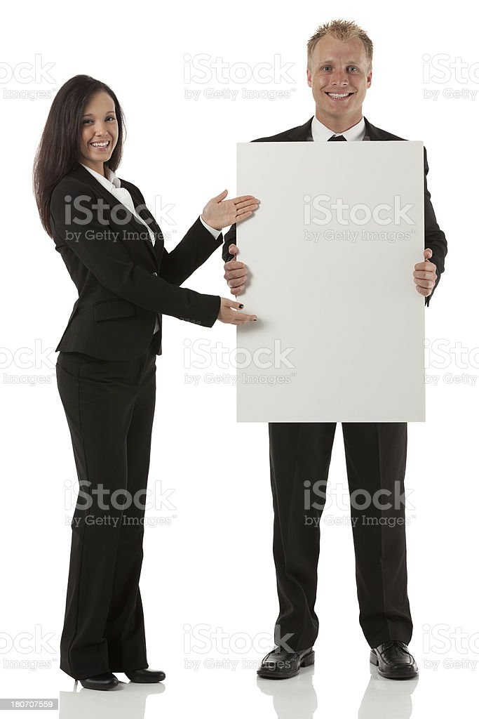 Business executives with blank board royalty-free stock photo