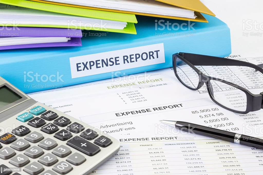 Business expense report with binder stock photo